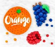 Plasticine fruits orange Stock Image