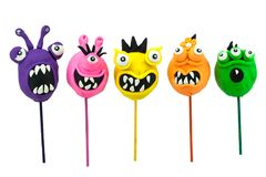 Plasticine funny lollipop monsters Royalty Free Stock Photography