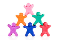 Plasticine guys making a human pyramid Stock Photo