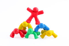 Plasticine guys making a human pyramid Royalty Free Stock Images