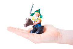 Plasticine hack. Plasticine artifact in your hand Royalty Free Stock Photography