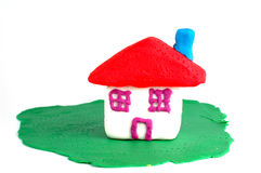 Plasticine house. House ,made on plasticine ,isolated on white background Stock Photography