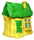 Plasticine house. Small yellow house with green roof maded from plastiline Stock Photography