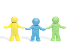 Plasticine human figures. On a white background Stock Photography