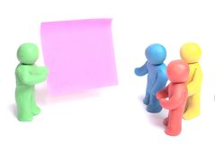 Plasticine human figures. On a white background Royalty Free Stock Photography