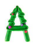Plasticine letter, bloomer 'A'. Plasticine letter, bloomer 'H'. Made in the form of Christmas tree Royalty Free Stock Photo