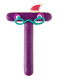 Plasticine letter, purple bloomer 'T'. Made in form of funny man with red cap Royalty Free Stock Photography