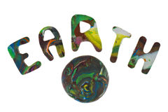 Plasticine letters forming word Earth written Stock Image