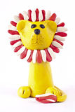 Plasticine lion. There is plasticine lion isolated over white Royalty Free Stock Photos