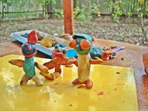 Plasticine little men colorful, funny royalty free stock photo