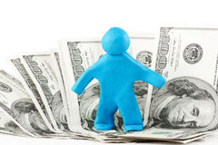 Plasticine man with banknote Stock Photos
