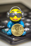 Plasticine man with euro coin Royalty Free Stock Images