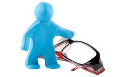 Plasticine man with eyeglass Stock Image