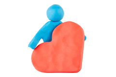 Plasticine man with heart Royalty Free Stock Photo