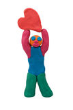 Plasticine man hold heart Royalty Free Stock Images