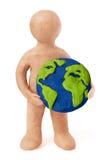 Plasticine man holding earth Royalty Free Stock Image