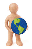 Plasticine man holding earth Stock Images