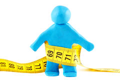 Plasticine man with measuring tape Royalty Free Stock Images