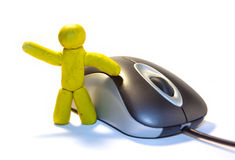 Plasticine man and mouse. Plasticine man and computer mouse Stock Images