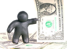 Plasticine man with one dollar banknote. Plasticine man with banknote one dollar on dollar background Royalty Free Stock Photo