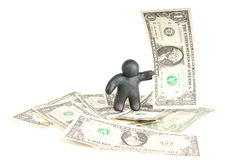 Plasticine man with one dollar banknote. Plasticine man with banknote one dollar on dollar background Stock Photography
