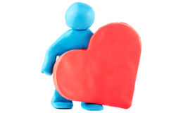 Plasticine man with plasticine heart Stock Image