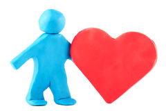 Plasticine man with plasticine heart Royalty Free Stock Images