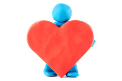 Plasticine man with plasticine heart Stock Photo