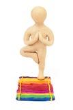 Plasticine man in vrikshasana Royalty Free Stock Image