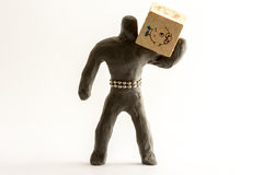 Plasticine man. With a wooden cube Royalty Free Stock Images