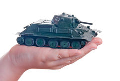 Plasticine model of a tank in the palm of your han. D on a white background Stock Photo