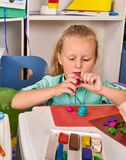 Plasticine modeling clay. Child dough play in school. stock photo