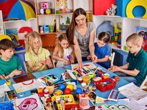 Plasticine modeling clay in children class. Clay projects teacher school. Plasticine modeling clay in children class. Clay projects with teacher teaches kids royalty free stock photos