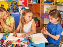 Plasticine modeling clay in children class. Teacher teaches in school. Plasticine modeling clay in children class. Kids together play dough and mold from royalty free stock photo