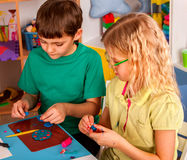 Plasticine modeling clay in children class in school. Plasticine modeling clay in children class. kids together play dough and mold from plasticine in royalty free stock photo