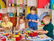 Plasticine modeling clay in children class. Teacher teaches in school. Plasticine modeling clay in children class. Teacher teaches kids together play dough and royalty free stock photo