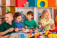 Plasticine modeling clay in children class. Teacher teaches in school. Stock Photos