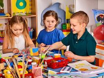 Plasticine modeling clay in children class. Teacher teaches in school. Royalty Free Stock Image
