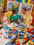 Plasticine modeling clay in children class. Teacher teaches in school. Stock Photos
