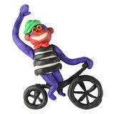 Plasticine monkey on the bicycle Royalty Free Stock Photos