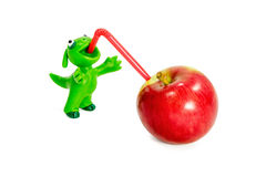 Plasticine monster drinking apple Royalty Free Stock Images