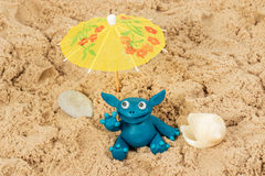 Plasticine monster on the sand Royalty Free Stock Image