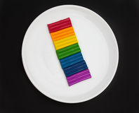 Plasticine multicolored on white plate Stock Images