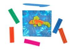 Plasticine op een witte achtergrond Stock Foto