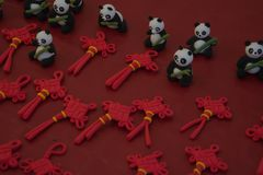 Plasticine panda bears and Chinese knot ornament with red background royalty free stock photography
