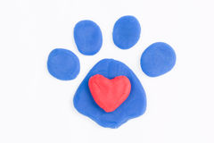 Plasticine paw and heart. Stock Images