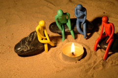 Plasticine People Around Fire Stock Image