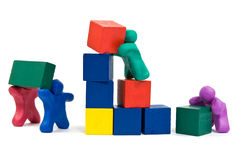 Plasticine people building wooden blocks Royalty Free Stock Photo