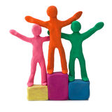 Plasticine people celebrate victory Royalty Free Stock Image