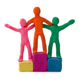 Plasticine people celebrate victory Royalty Free Stock Images